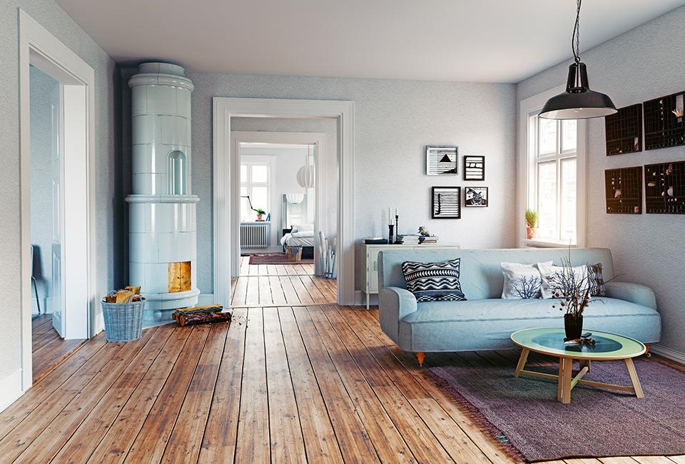 """Parquet e tappeti per creare delle """"isole"""". Arredamento d'interni, vista della casa dal salotto, con parquet e tappeto"""