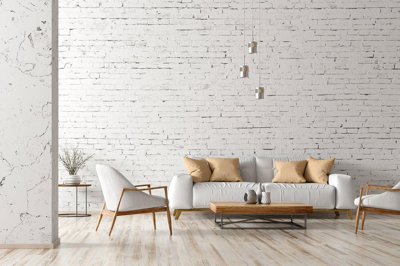 Un salotto total white con parquet